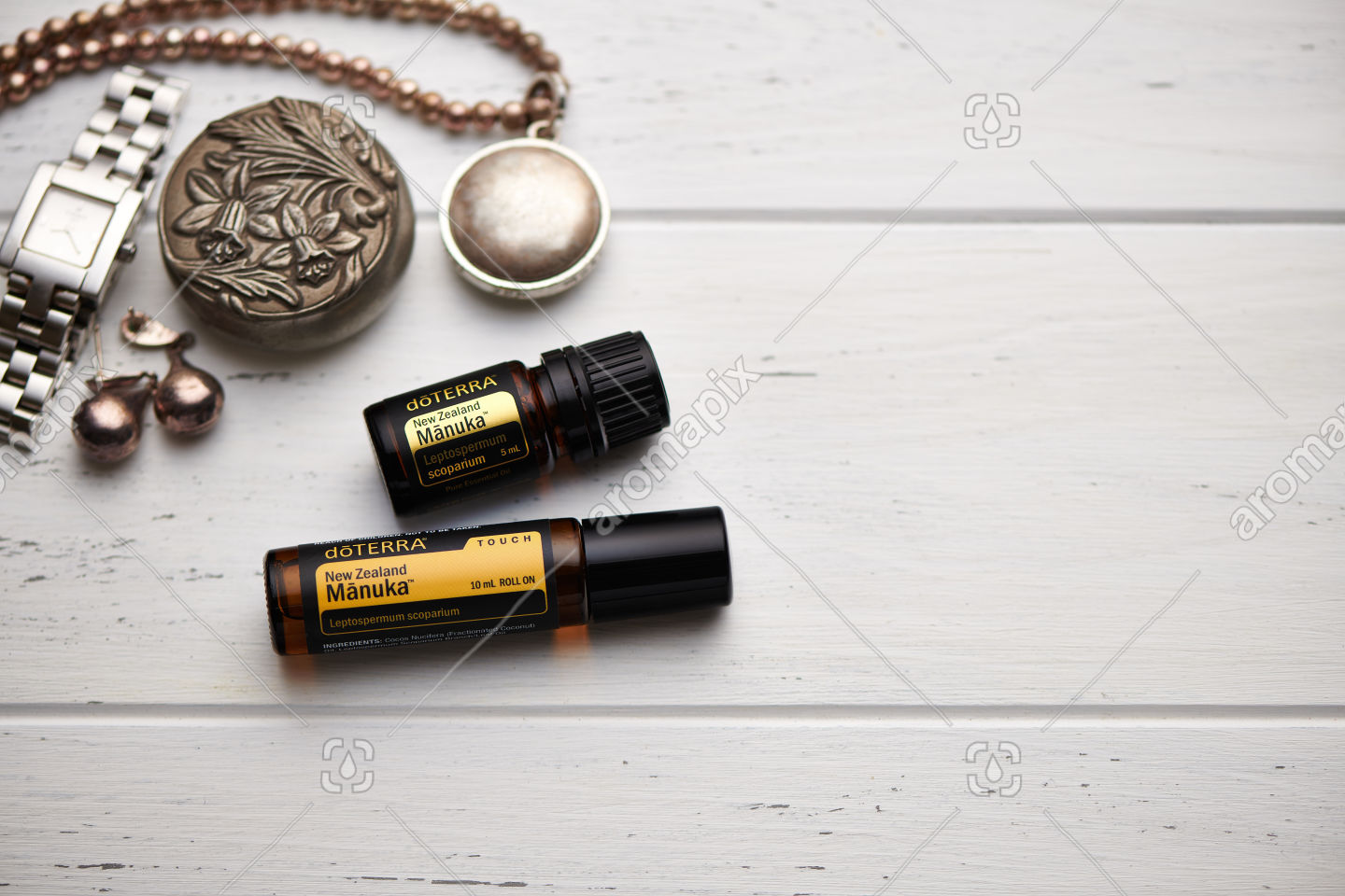 doTERRA Manuka and Manuka Touch on rustic background