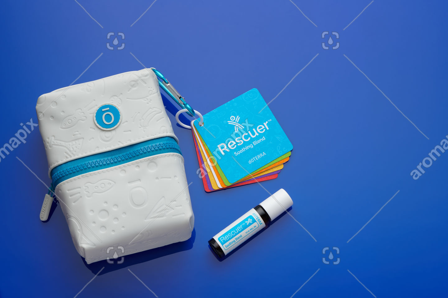 doTERRA Kids Oil Collection case, flashcards and Rescuer on blue