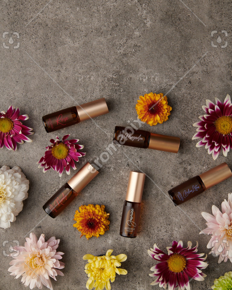 doTERRA Neroli Touch, Jasmine Touch, Rose Touch, Magnolia Touch and Blue Lotus Touch with flowers
