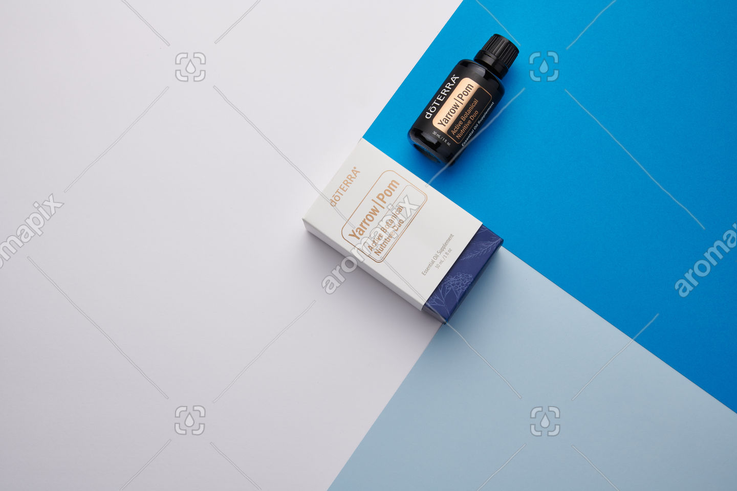 doTERRA Yarrow Pom and box on blue and white geometric background