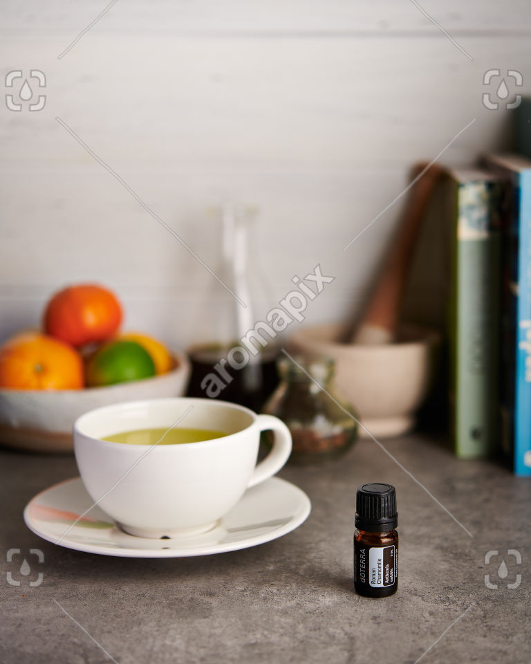 doTERRA Roman Chamomile and chamomile tea on a kitchen bench