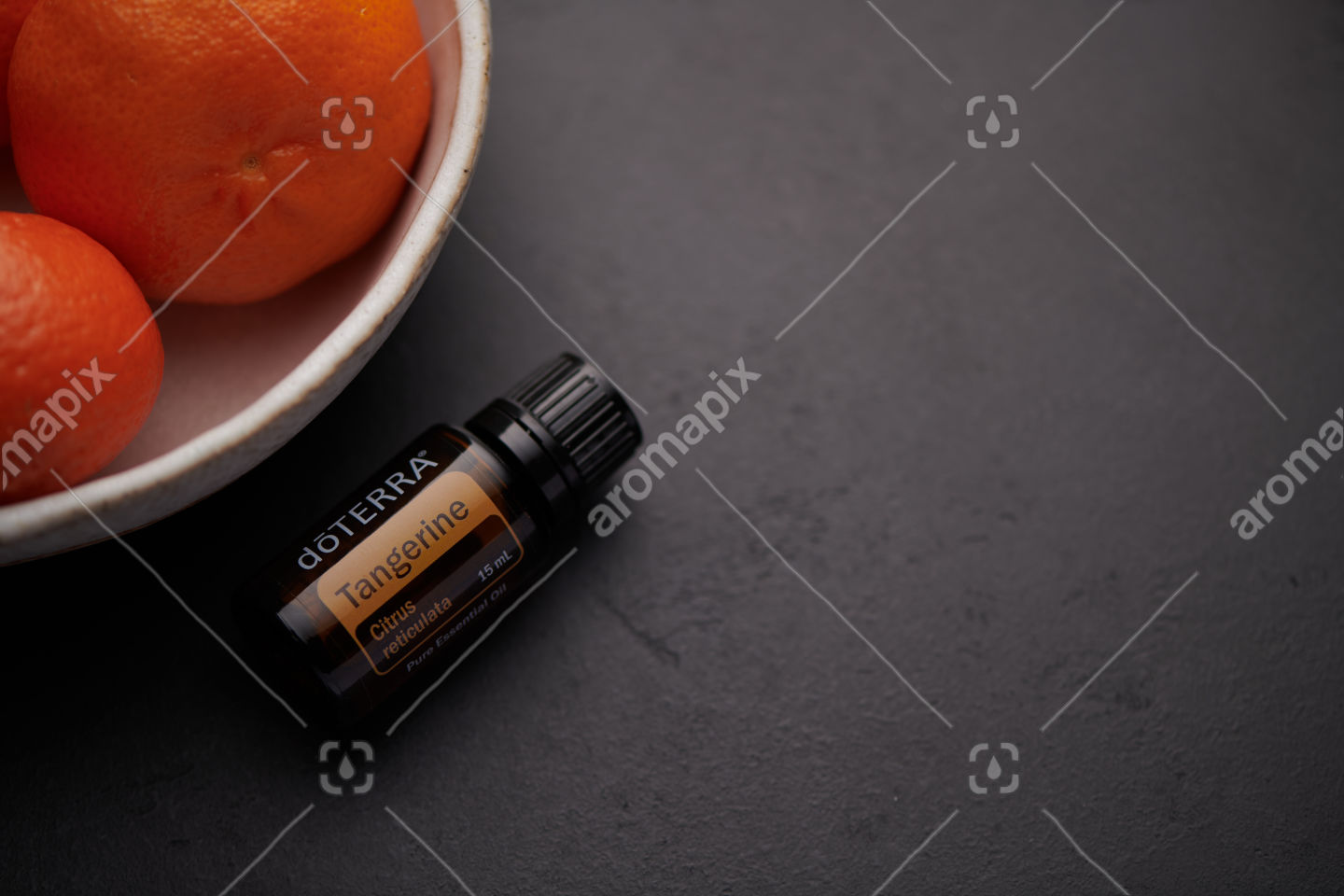doTERRA Tangerine product and fruit in white bowl