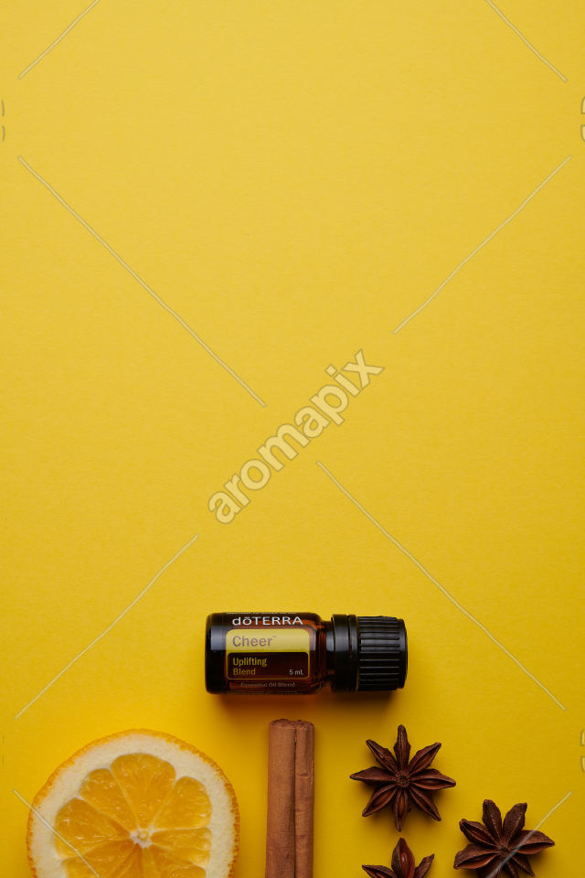 doTERRA Cheer with spices on yellow