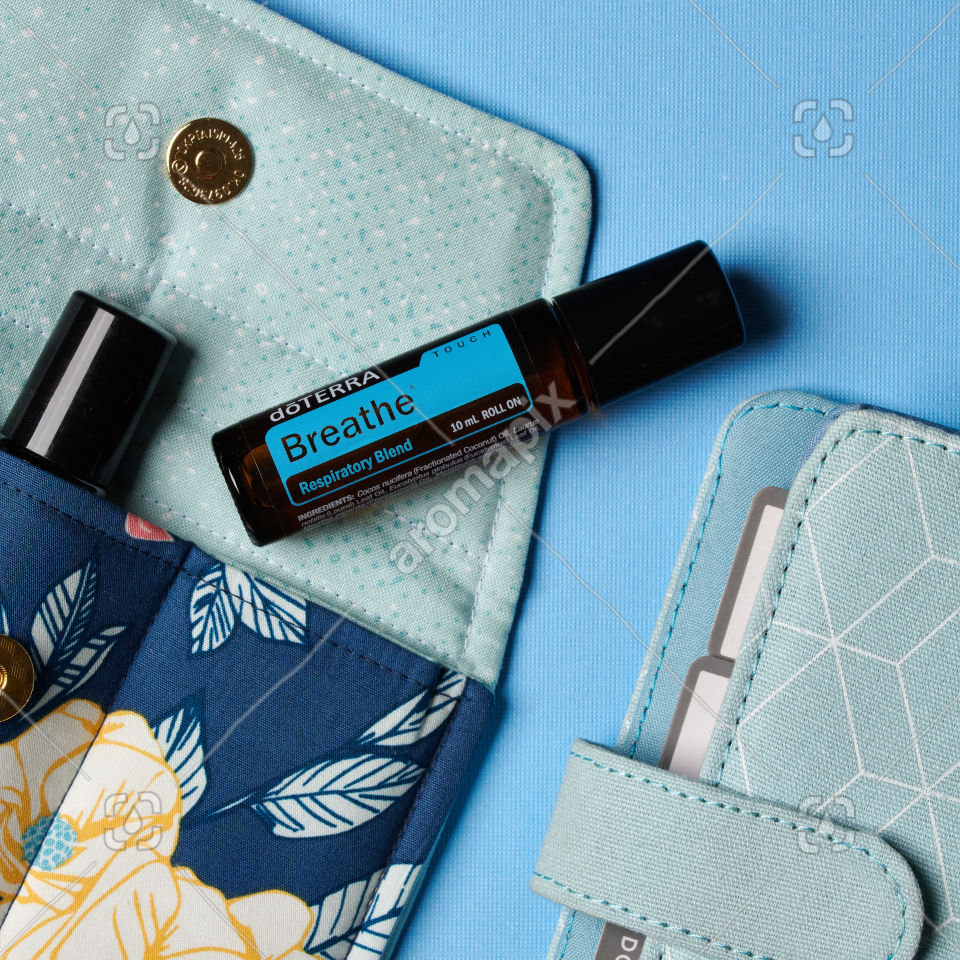 doTERRA Breathe Touch with accessories on blue