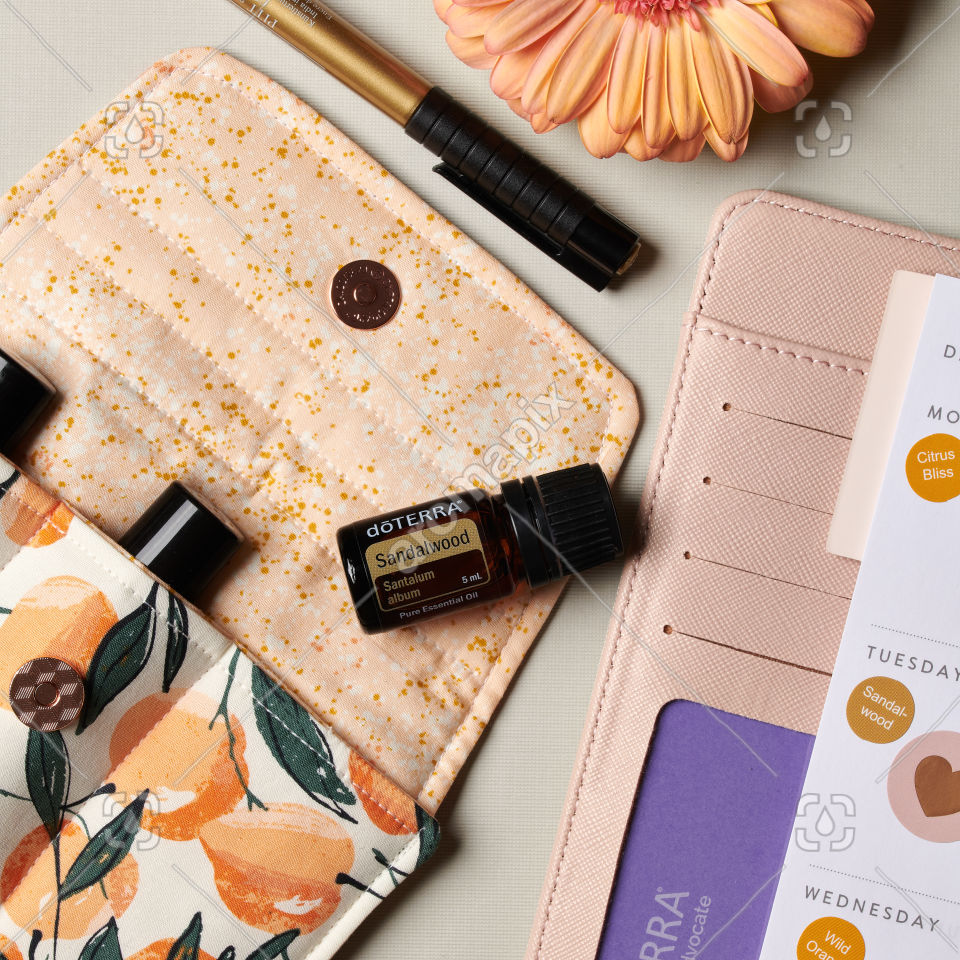 doTERRA Sandalwood essential oil and accessories on white