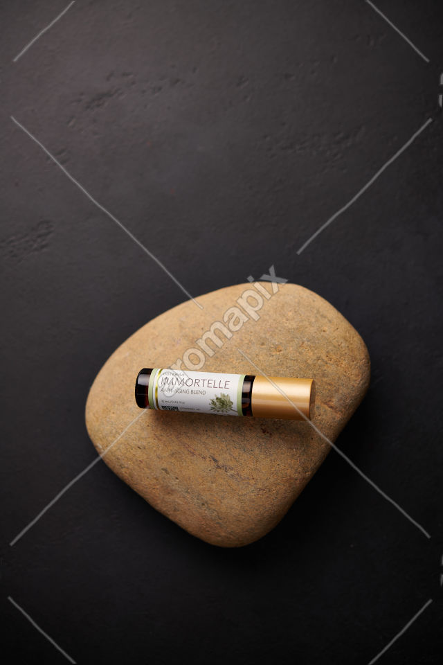 doTERRA Immortelle on a stone on black