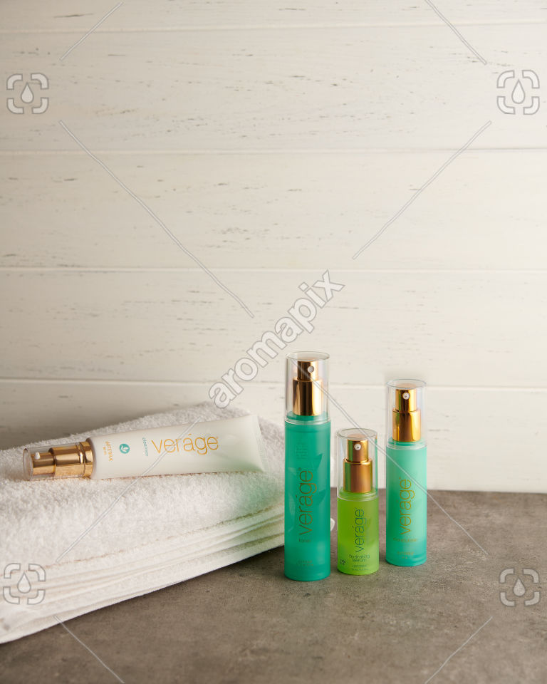 doTERRA Verage Skin Care Collection and towel on a bathroom bench top