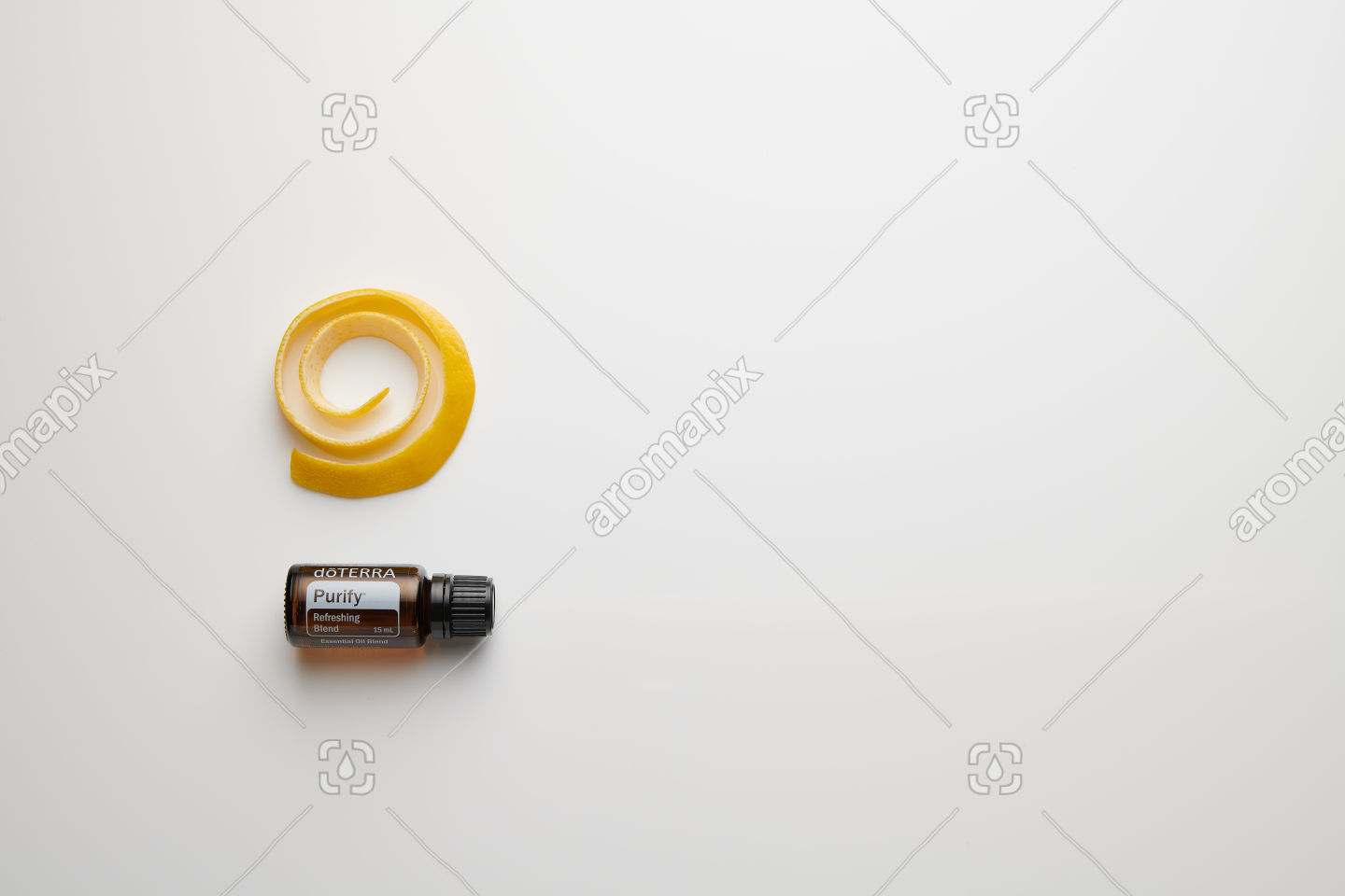 doTERRA Purify with lemon peel on white perspex