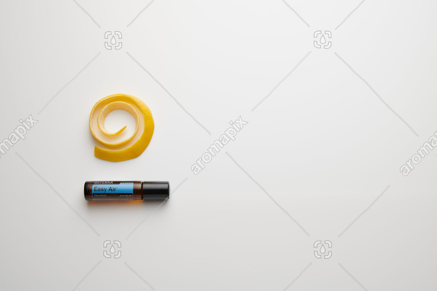 doTERRA Easy Air Touch with lemon peel on white perspex
