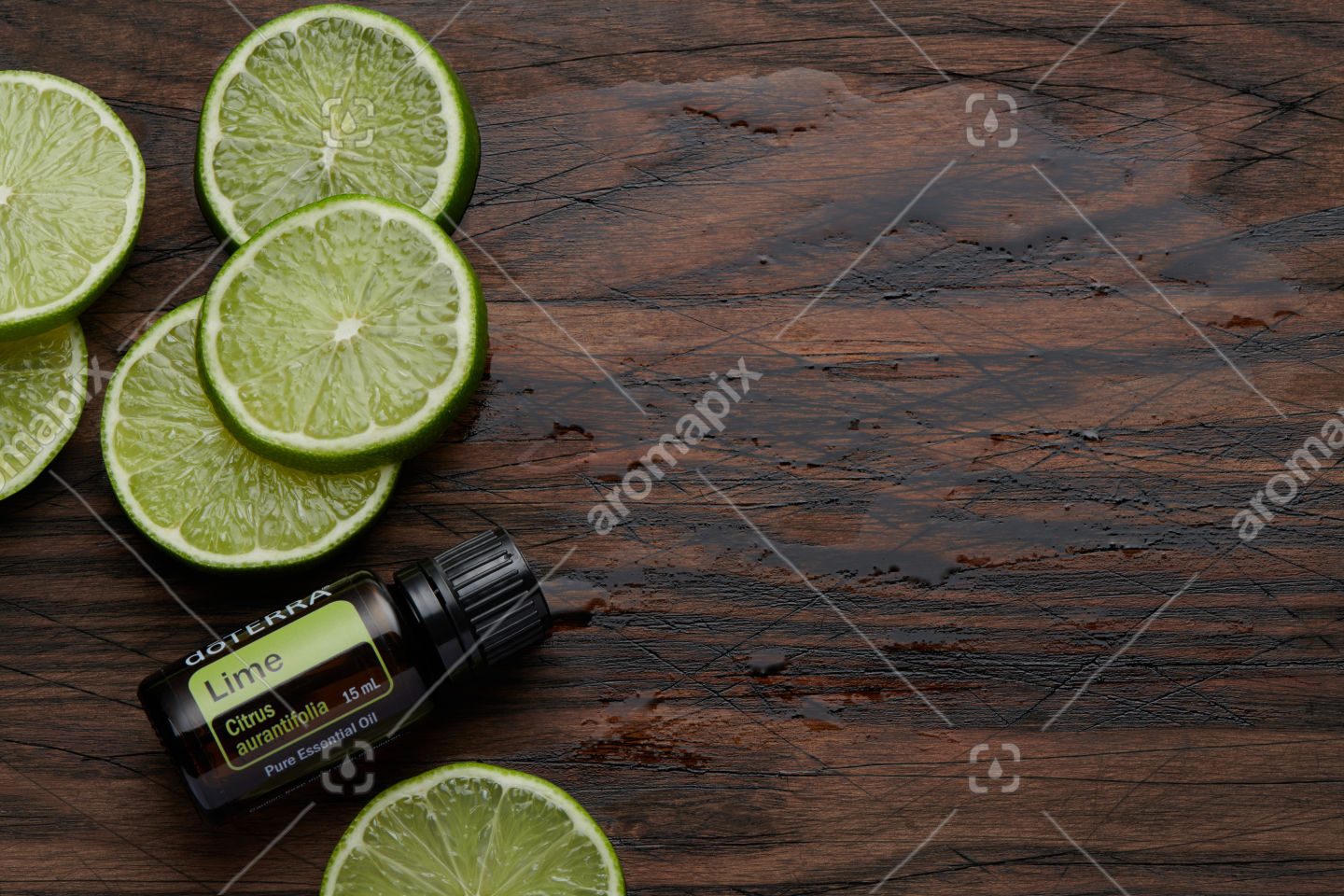 doTERRA Lime product and lime slices on wooden board