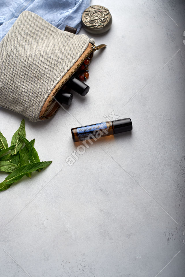 doTERRA Peppermint Touch with mint leaves on white