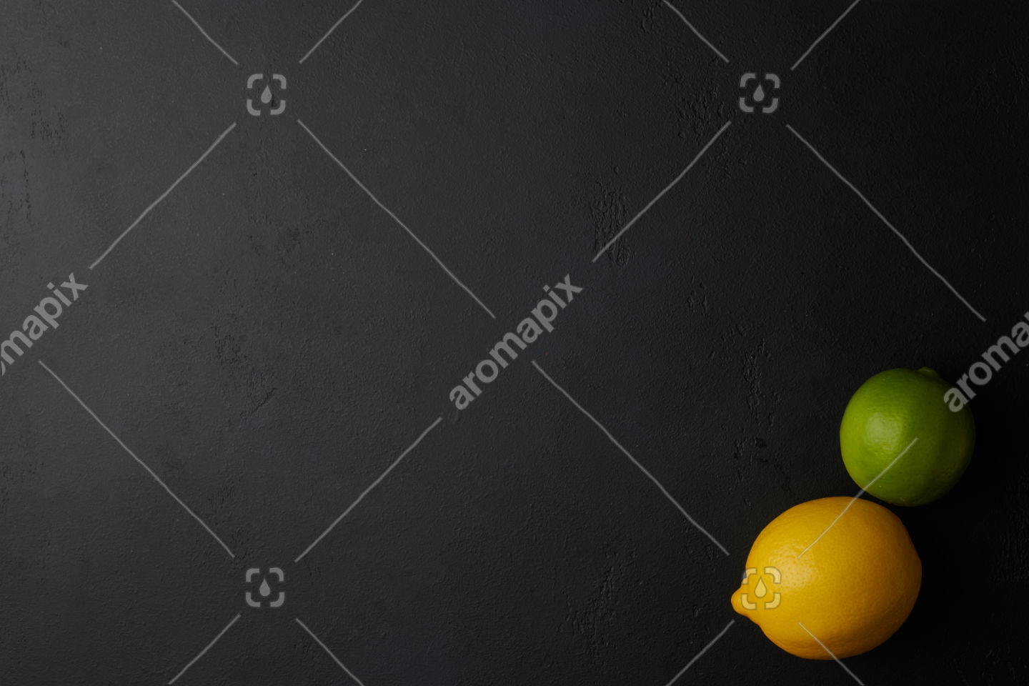 Lemon and lime fruit on black concrete