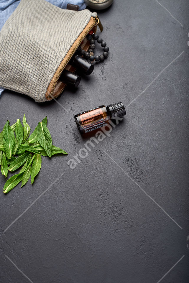doTERRA Slim and Sassy with mint leaves on black