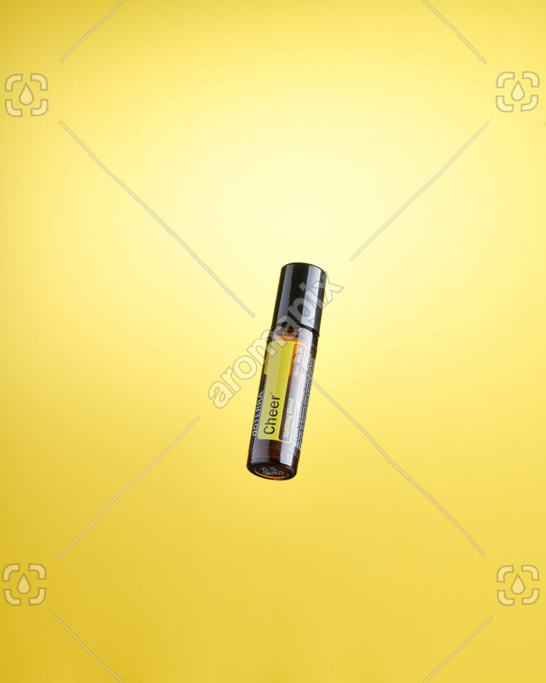 doTERRA Cheer Touch floating on yellow