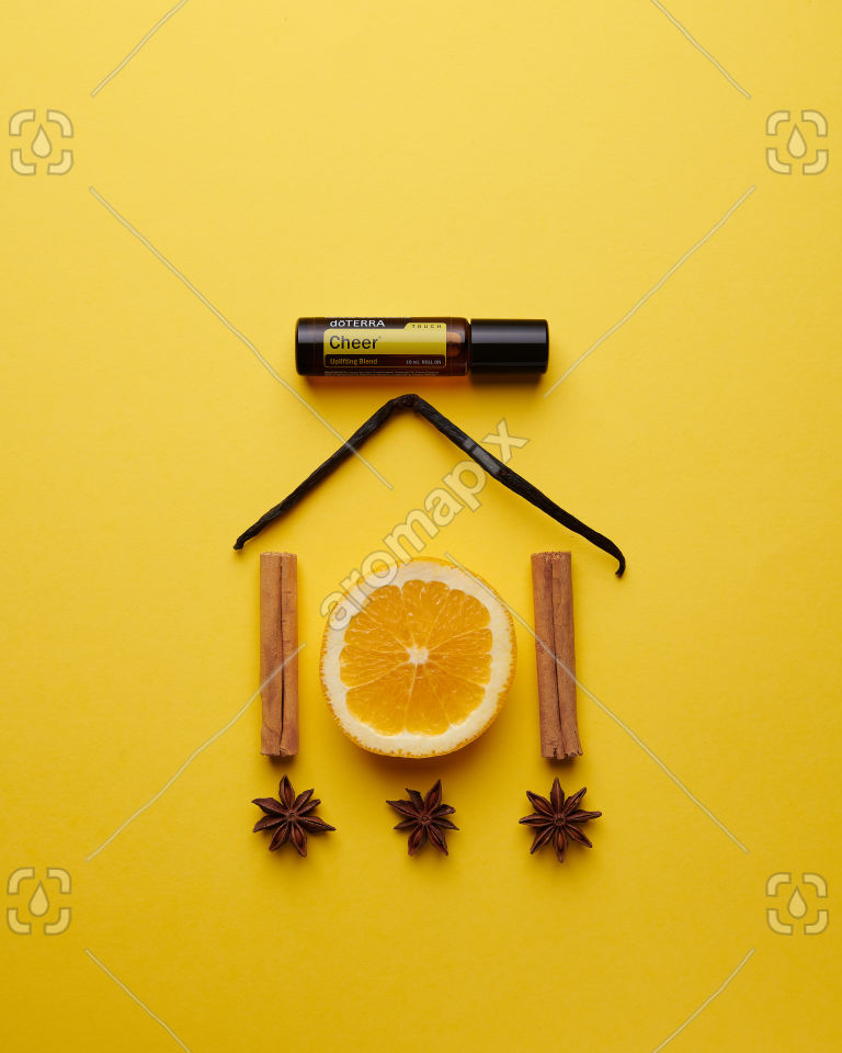 doTERRA Cheer Touch with spices on yellow