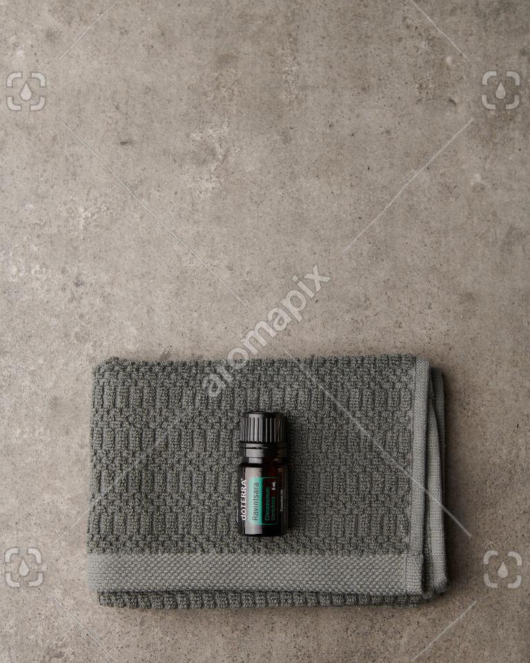 doTERRA Ravintsara on a washcloth on gray
