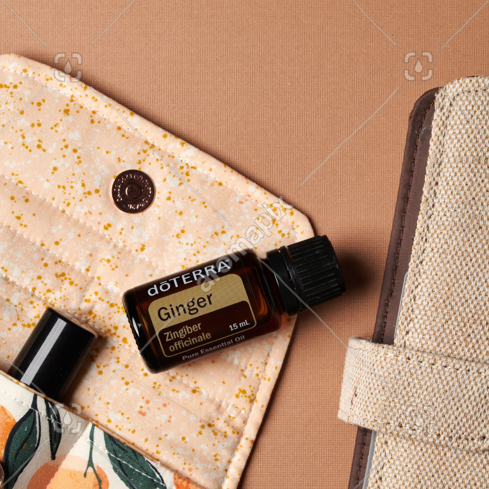 doTERRA Ginger essential oil with accessories on brown