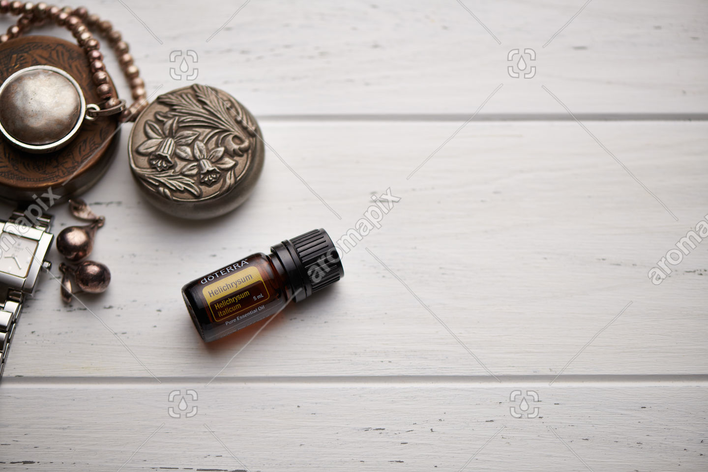 doTERRA Helichrysum on rustic background