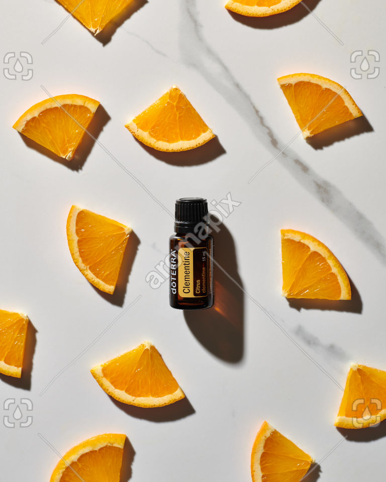 doTERRA Clementine essential oil and citrus slices on white