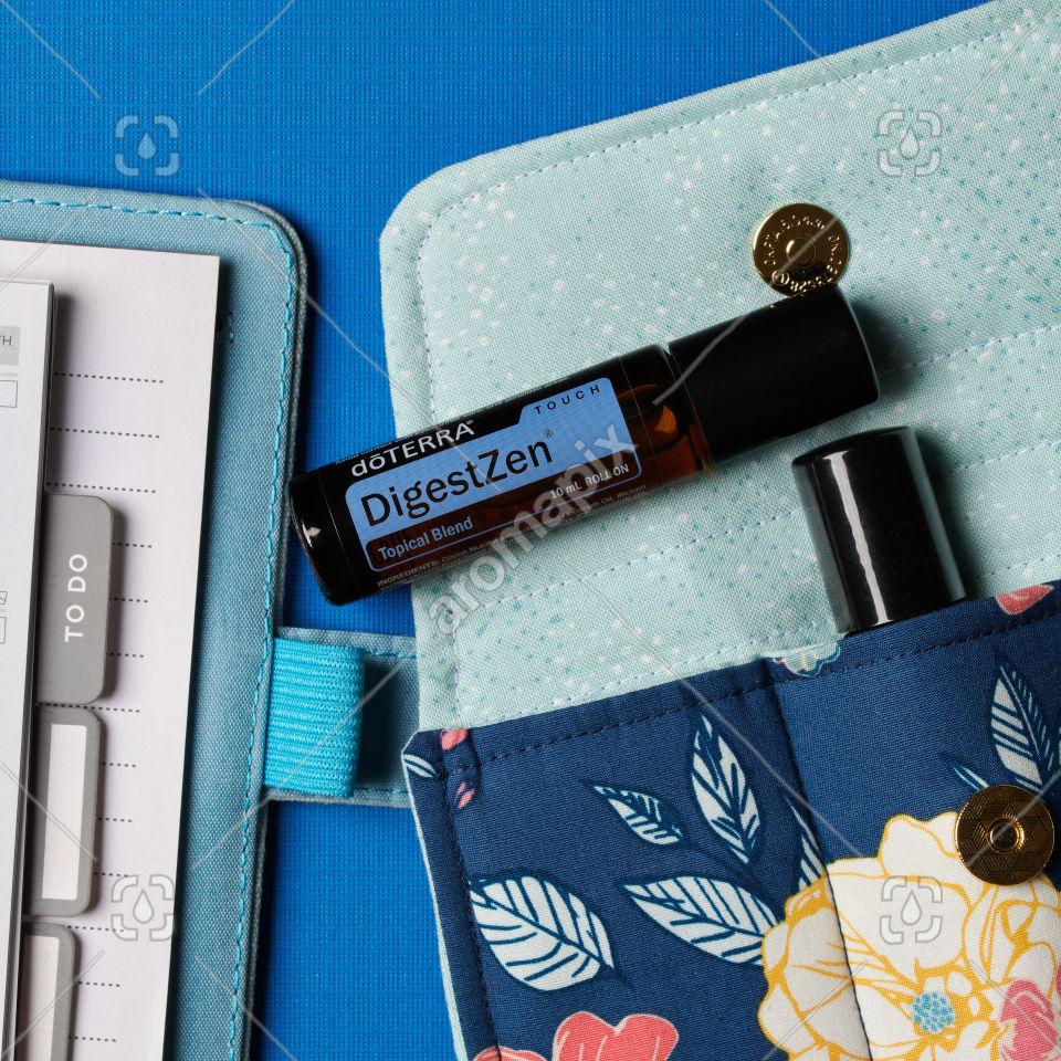 doTERRA DigestZen Touch with accessories on blue
