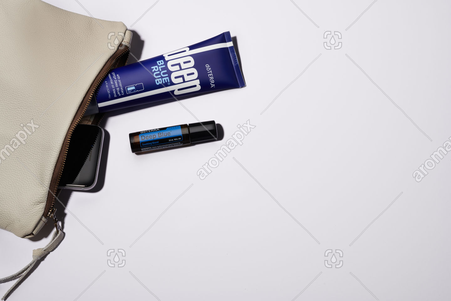 Woman's clutch with Deep Blue Rub, Deep Blue Touch and phone on white background