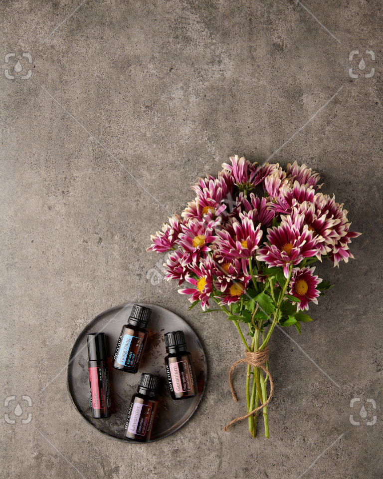 doTERRA Rose Touch, Ylang Ylang, Lavender and Geranium with flowers on gray