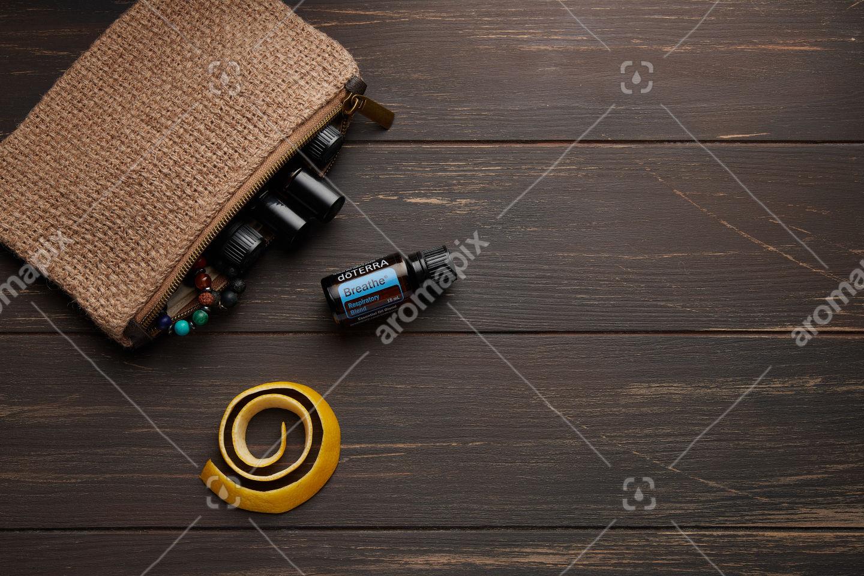 doTERRA Breathe with lemon peel on wooden background