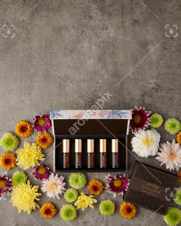 doTERRA Precious Florals Collection with flowers on gray