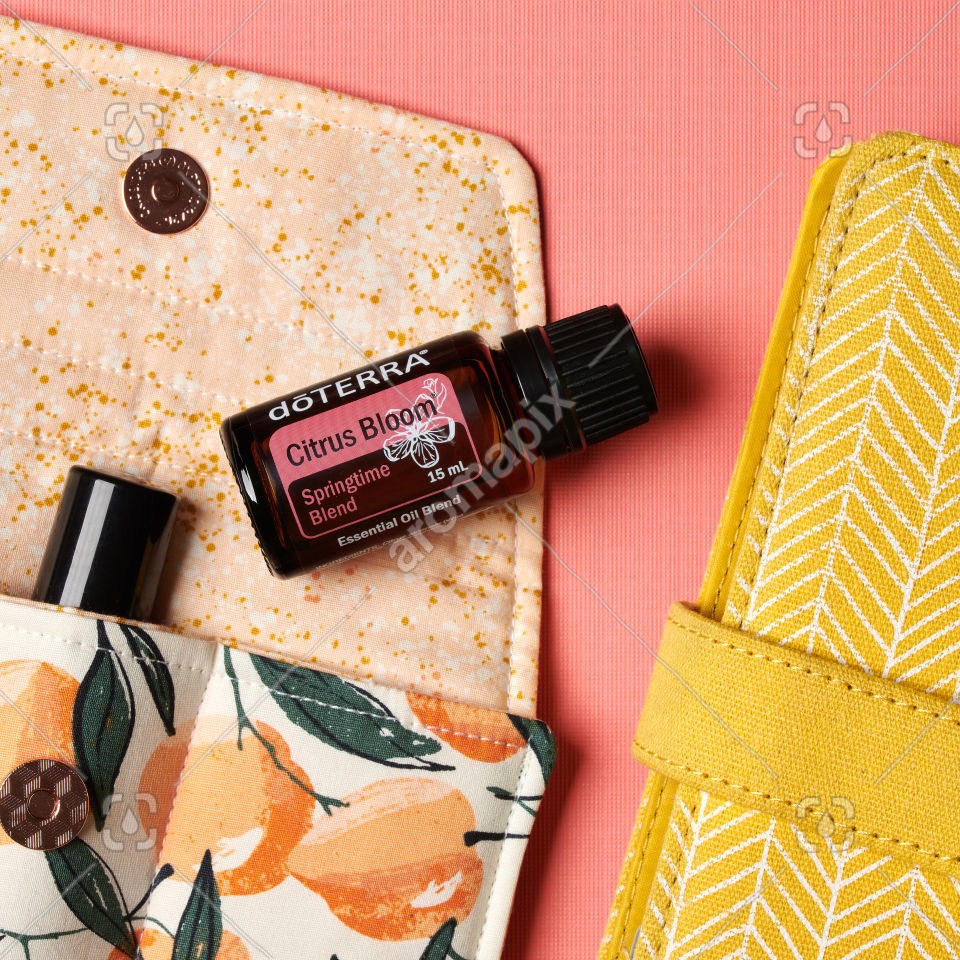 doTERRA Citrus Bloom with accessories on coral pink