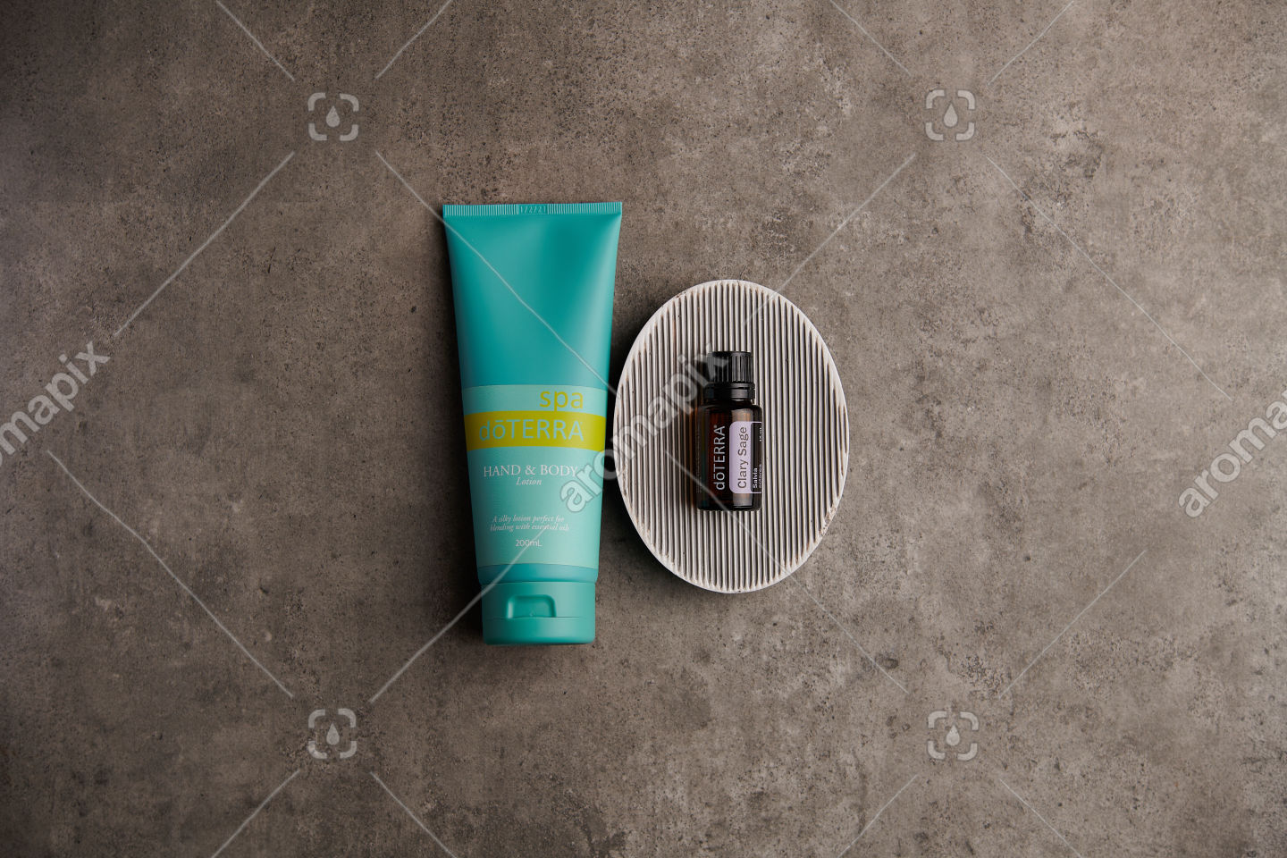 doTERRA Spa Hand and Body Lotion and Clary Sage essential oil on stone