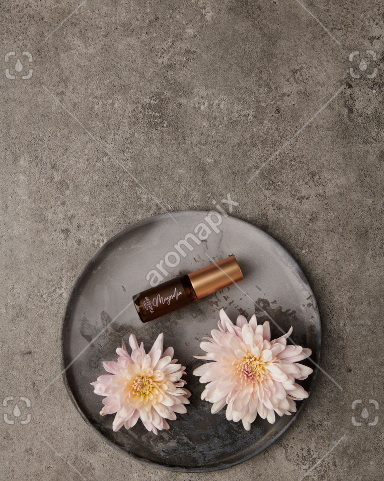 doTERRA Magnolia Touch 4ml with flowers on gray