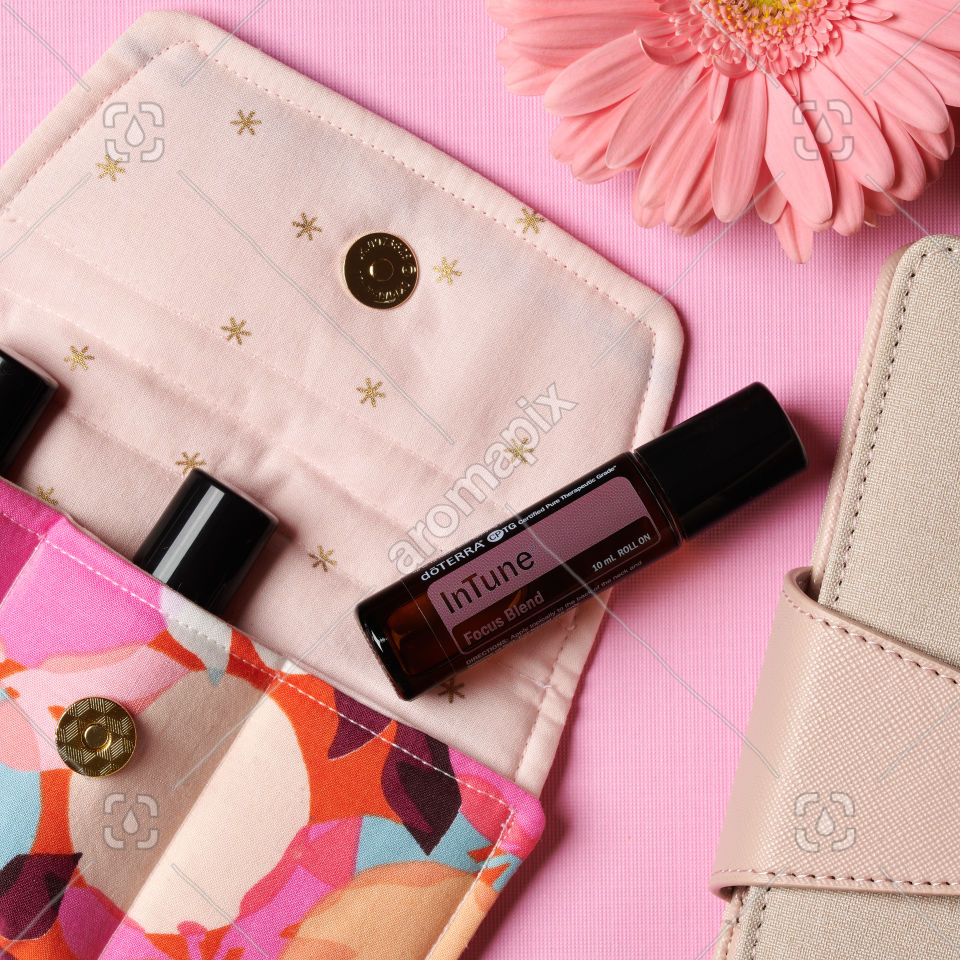 doTERRA InTune and accessories on pink