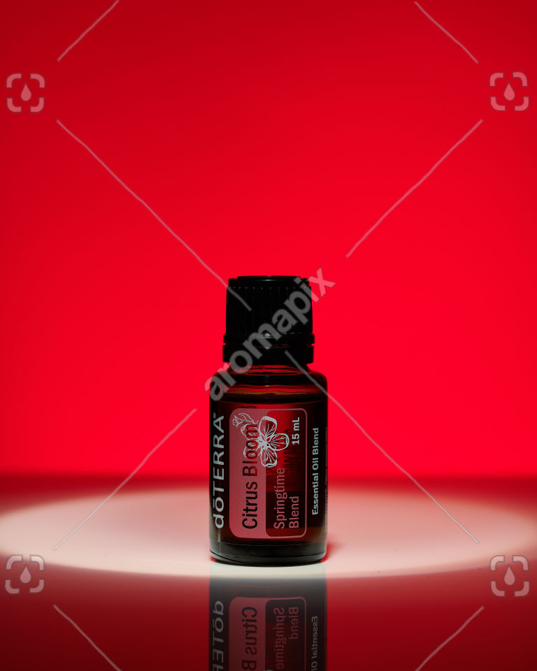doTERRA Citrus Bloom essential oil on red