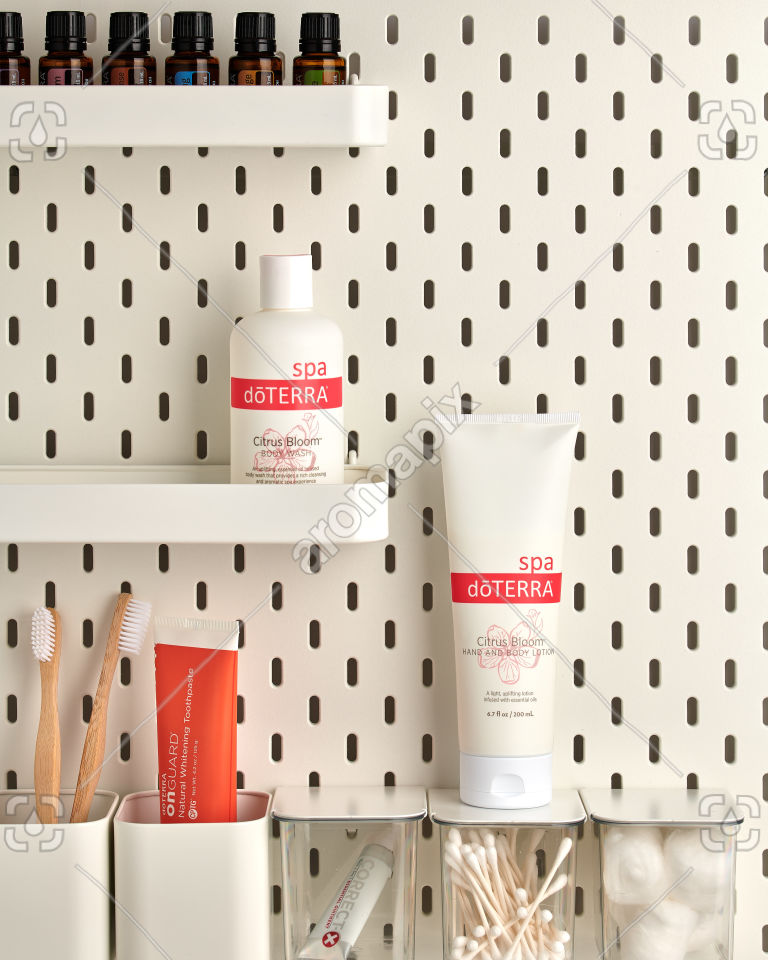 doTERRA Citrus Bloom Body Wash and Citrus Bloom Hand and Body Lotion on bathroom shelf