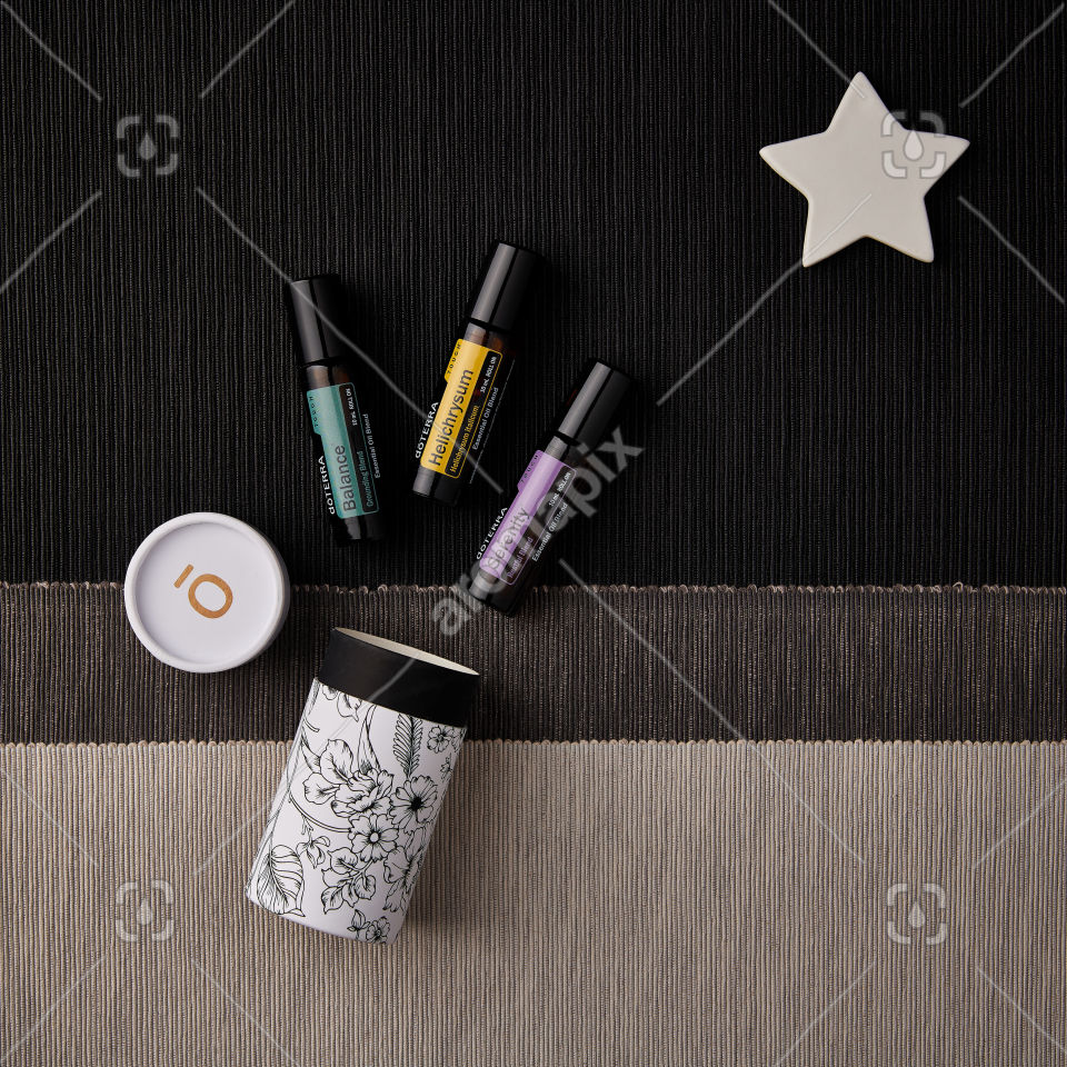 doTERRA Balance Touch, Helichrysum Touch, and Serenity Touch with holiday decorations on a textured background
