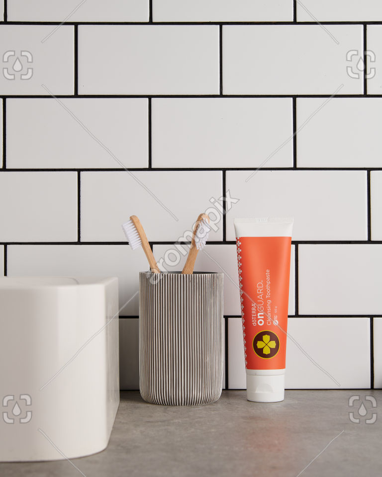 doTERRA On Guard Natural Cleansing Toothpaste with bathroom accessories in bathroom