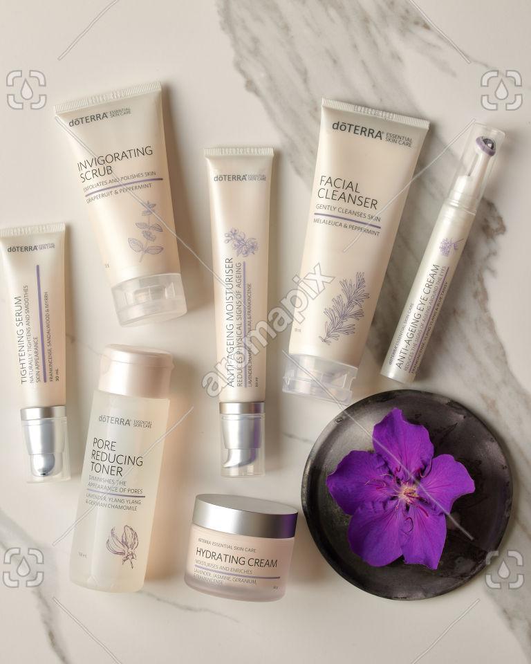 doTERRA Tightening Serum, Pore Reducing Toner, Invigorating Scrub, Anti-Ageing Moisturiser, Hydrating Cream, Facial Cleanser and Anti-Ageing Eye Cream on white marble