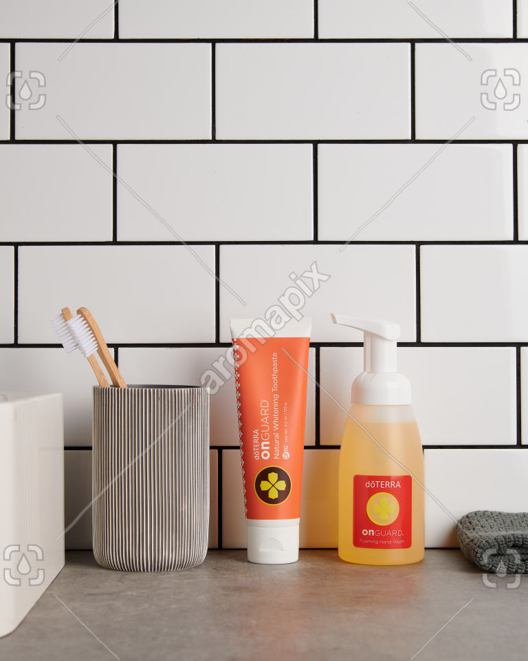 doTERRA On Guard Natural Whitening Toothpaste and On Guard Foaming Handwash in bathroom