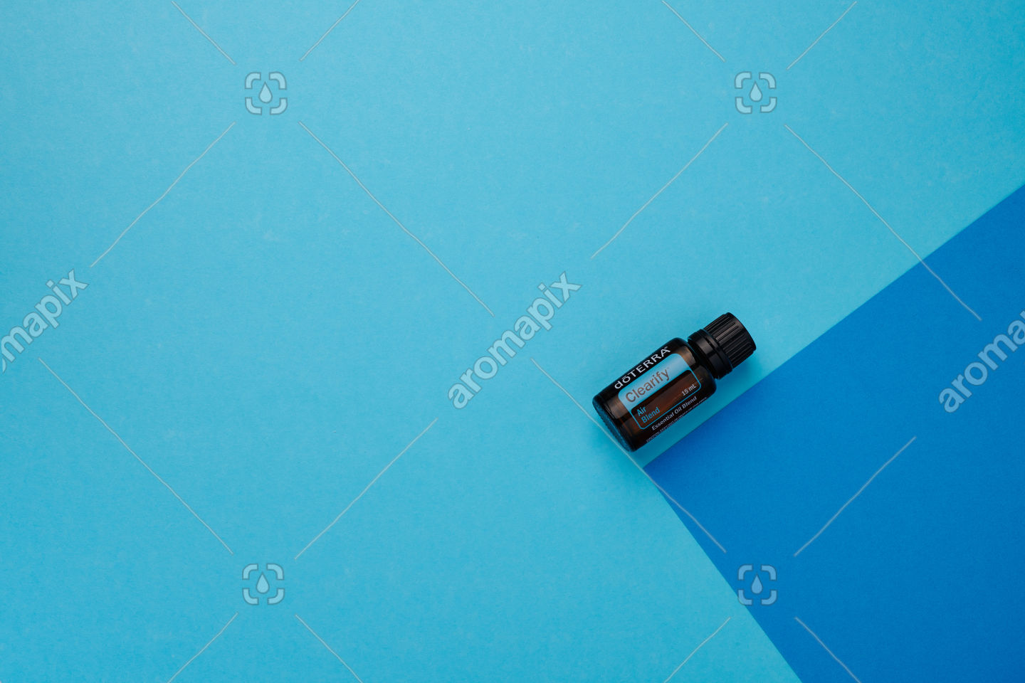 doTERRA Clearify on a dark blue and light blue background