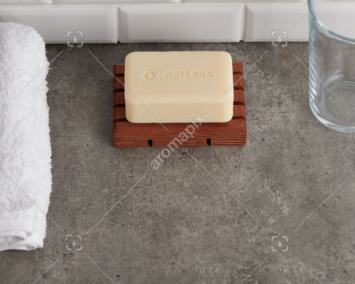 doTERRA Spa Moisturizing Bath Bar on a bathroom bench