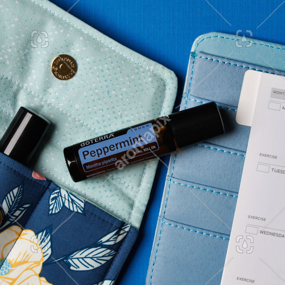 doTERRA Peppermint Touch with accessories on blue