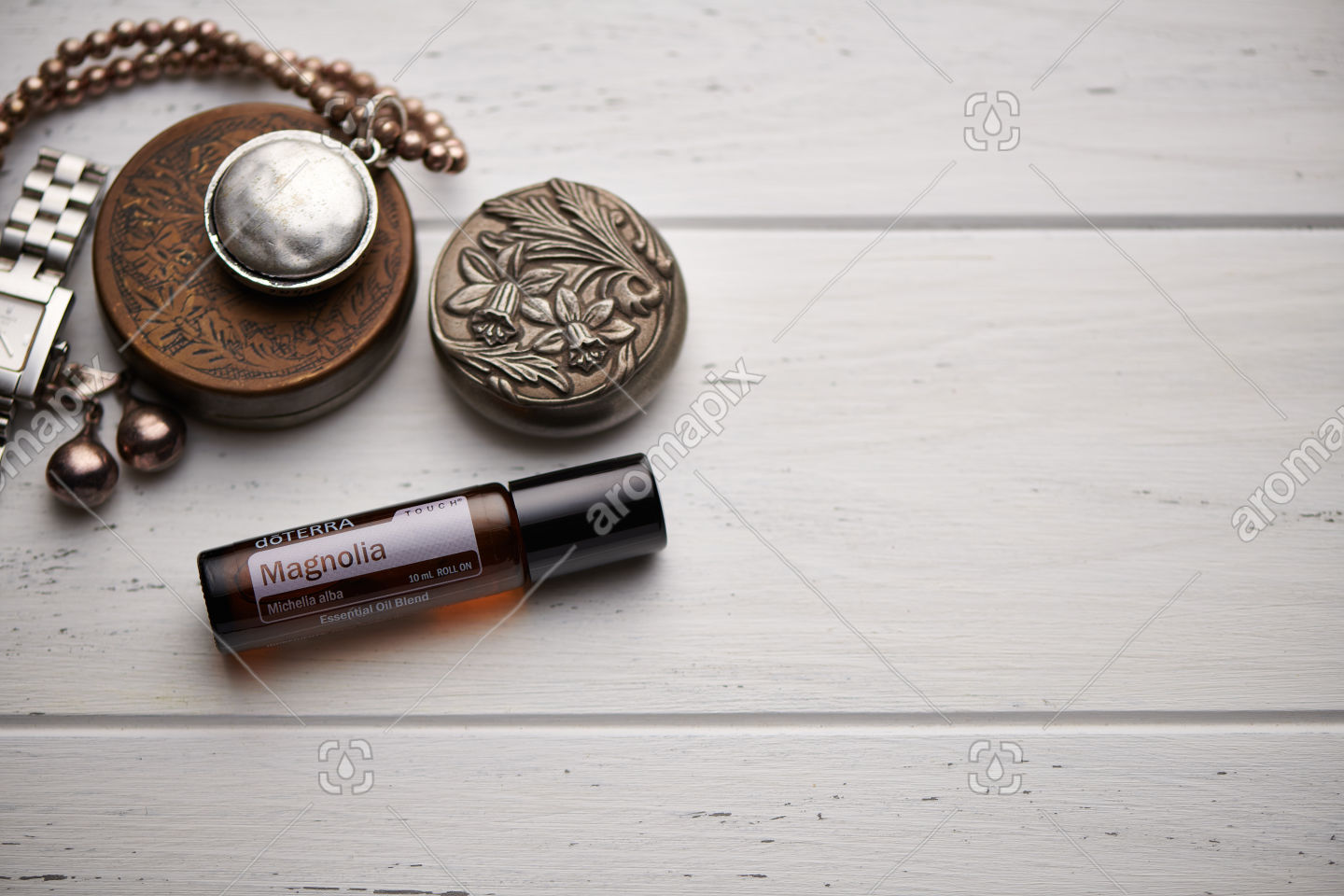 doTERRA Magnolia Touch on rustic background