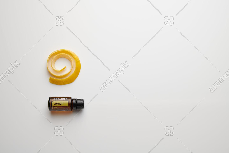 doTERRA Lemon with lemon peel on white perspex
