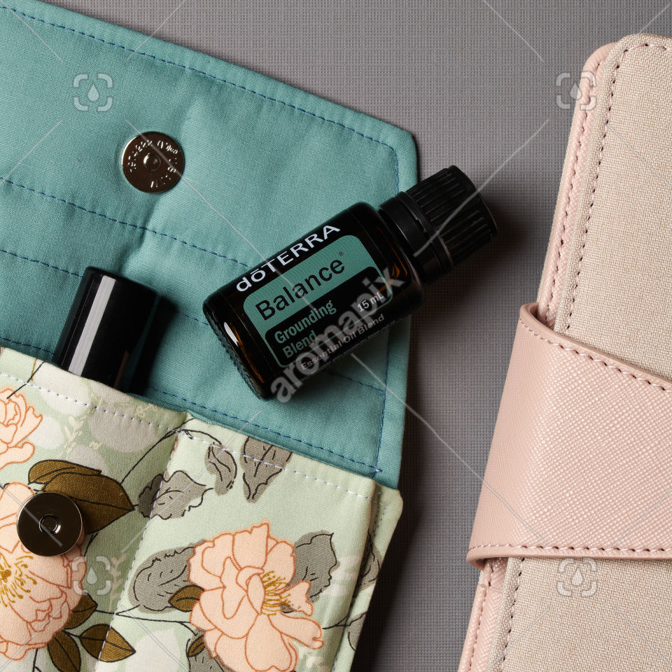 doTERRA Balance Grounding Blend and accessories on gray