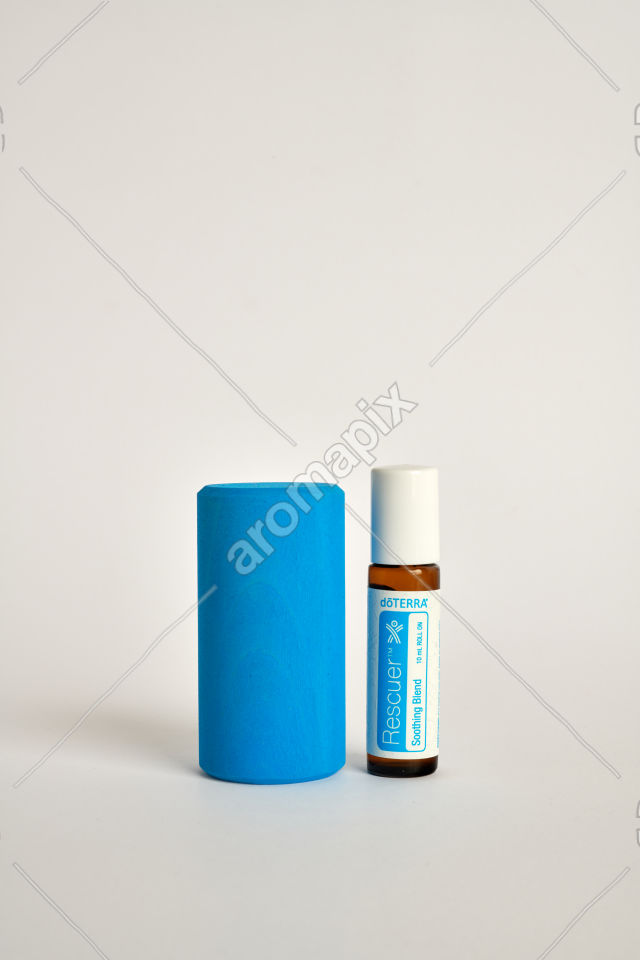 doTERRA Kids Oil Collection Rescuer with a wood block