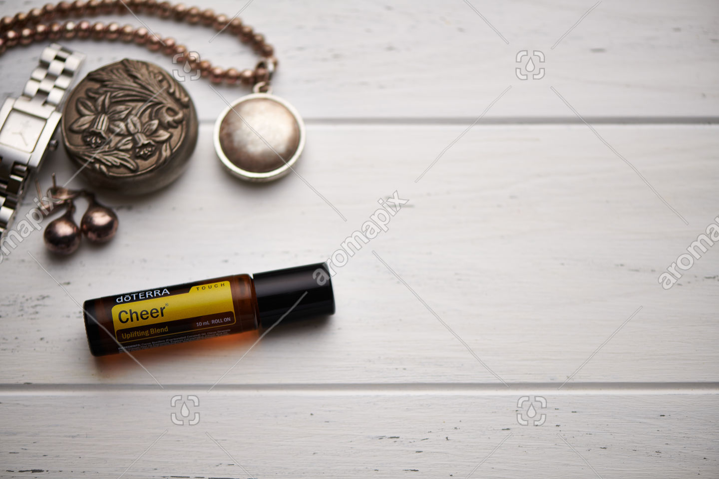 doTERRA Cheer Touch on rustic background