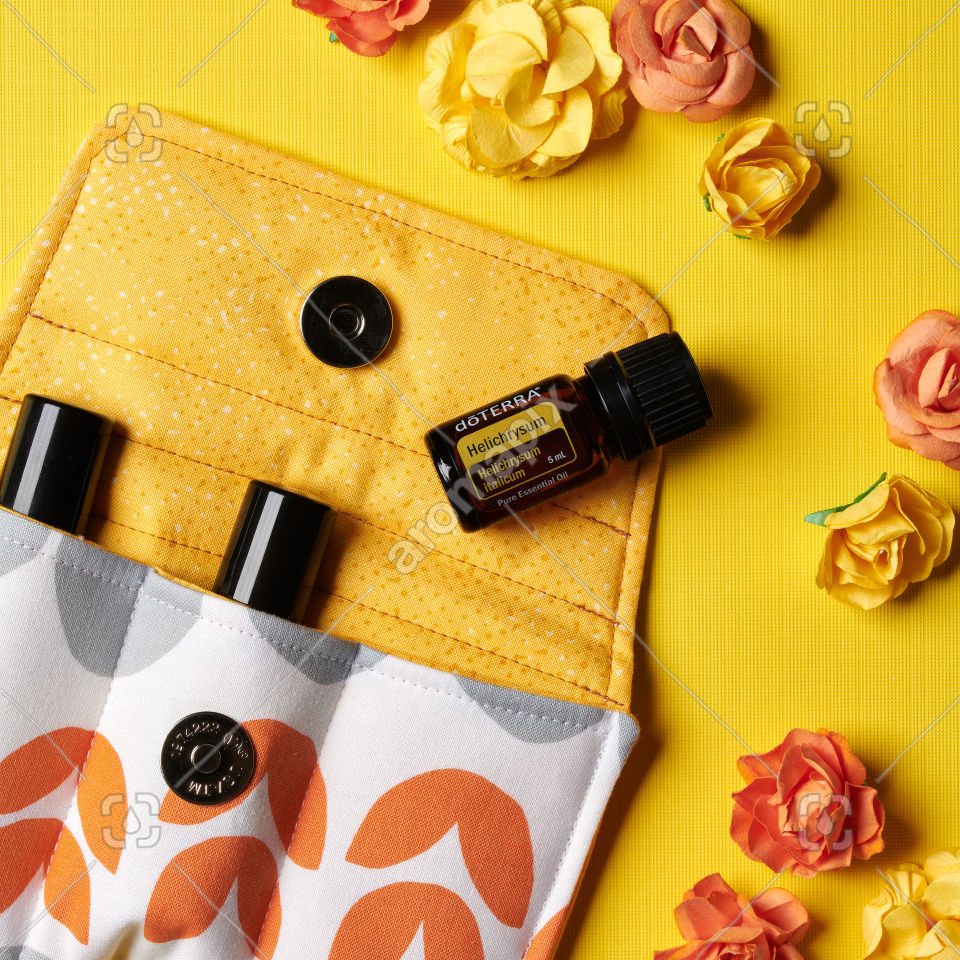 doTERRA Helichrysum with flowers on yellow