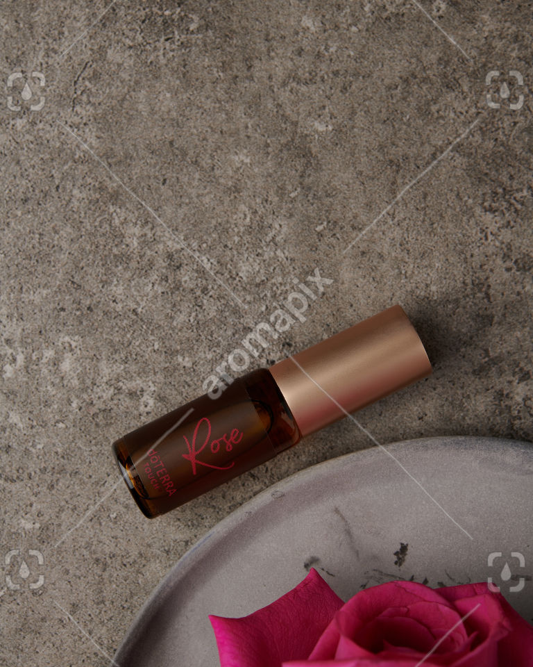 doTERRA Rose Touch 4ml with flowers on gray