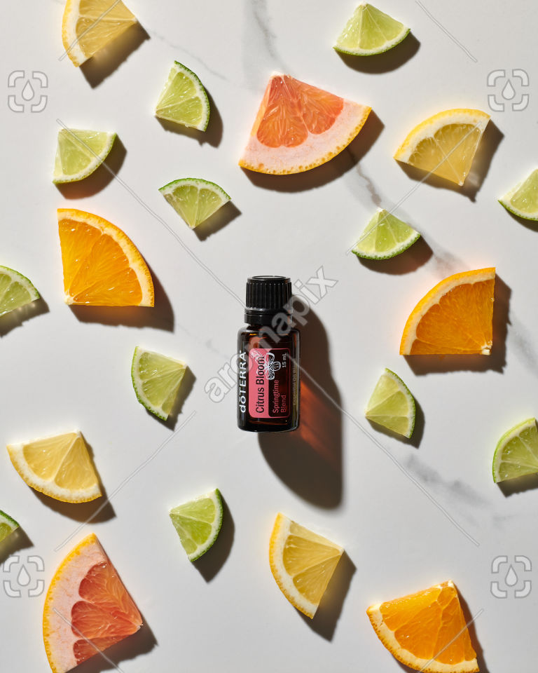 doTERRA Citrus Bloom essential oil blend and lime slices on white