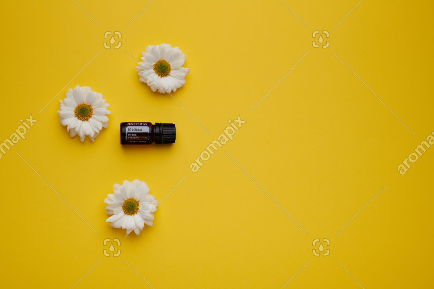 doTERRA Melissa with flowers on yellow
